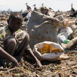 A young boy sifts through rubbish with his bare hands at Dandora dumpsite. Despite the risk of being cut by metal, pricked by used syringes or coming into contact with corrosive harmful chemicals, children who are sometimes forced by their parents to work in the dumpsite expose themselves to many health risks.