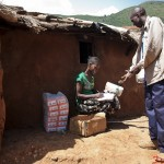 Jennifer Simpili sells maize floor to a customer in her shop at Mai Mahiu. She is a student at the functional adult literacy class at Canan Primary School. From the classes she has been able to learn how to keep good books and track payments, credits and  supplies.