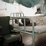 A young girl sleeps in the ward before her surgery at Nyabondo Rehabilitation Center.