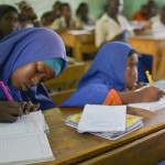 Female students take down notes at Al-Jaziira Primary School. In October 2013, the Federal Government of Somalia began a campaign that would hopefully see one million children back in school by 2016.