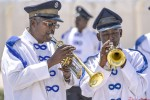 A young man plays his trumpet with an older Police Band mate on 1st March 2014 at Mogadishu Airport during an official ceremony. Somalia was known as a land of poets and musicians before the war, as peace and calm begins to return, older poets and musicians are teaching the younger generation how to play instruments, write as well as sing.