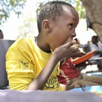 A young boy at Somali Orphans & Disable Homeless & Children Center in Taleeh Mogadishu a lunch. The center caters for children who have been orphaned by the war and were once street children.