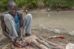 Bor Aiwa, group leader of Baping Fisheries Group, cuts and prepares the fish for drying before it is transported to the group drying area 25 kilometers away on 13th March 2015. Bor leads 30 of his fellow members in the group. The fishing hooks and nets are provided to all the group members who can catch up to 50 fish a day at SSP 20.